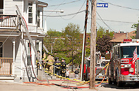 Baldwin Street fire Wednesday morning.  (Karen Bobotas/for the Laconia Daily Sun)Baldwin Street apartment complex fire Wednesday morning in Laconia, NH.  Karen Bobotas/for the Laconia Daily Sun
