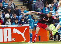 Photo: Kevin Poolman.<br />Reading v Stoke City. Coca Cola Championship. 17/04/2006. Reading's Kevin Doyle is held back by Stoke's Clint Hill.