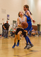 Belmont's Savannah Perkins goes around Gilford's Maura Hughes during the Senior Girls game at the 23rd annual Francoeur Babcock Memorial Tournament held at Gilford Middle School on Saturday afternoon.  (Karen Bobotas/for the Laconia Daily Sun)