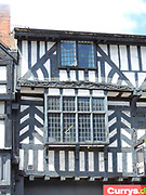 Half timbered Tudor buildings in Stratford upon Avon, England. These buildings date from 16th-17th century and are constructed using timber.