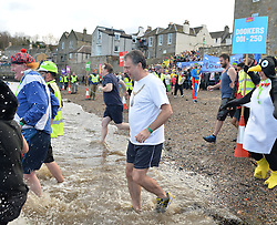 Edinburgh Lord Provost  Donald Wilson was amongst the first Loony Dookers of 2017 as he joined around 1000 other intrepid revellers in the annual event in the Forth on New Years Day.<br /> <br /> © Dave Johnston/ EEm