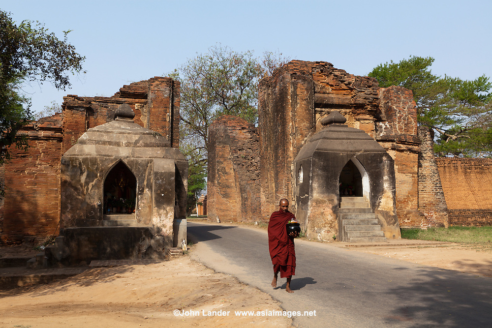At the East side of Old Bagan is Tharabar Gate, the best preserved remains of the 9th century wall surrounding the former original palace site.  The arched gateway has two niches which guard the gate and house Burmese nat, who guard the gate and are treated with profound respect by the locals.  One the left is Lady Golden Face and on the Right is her brother Lord Handsome.