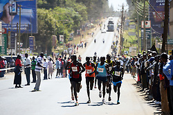 © Licensed to London News Pictures. 02/02/2014. Eldoret. Kenya. Running in Africa feature. Runners take part in the Eldoret Half Marathon Photo credit : Mike King/LNP