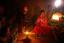 Sumeena Shreshta Balami, 15, sits with her groom, Prakash Balami, 16, for the first time in Kagati Village, Kathmandu Valley, Nepal on Jan. 24, 2007. The harmful traditional practice of early marriage is common in Nepal. The Kagati village, a Newar community, is most well known for its propensity towards this practice. Many Hindu families believe blessings will come upon them if marry off their girls before their first menstruation.