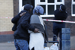 © Licensed to London News Pictures. 18/10/2018. London, UK. Friends and relatives of the victim console each other on the Doddington estate in Battersea after a man in his 40's died after an alleged assault. Police were called at around 5. 30pm to reports of several males fighting. Photo credit: Peter Macdiarmid/LNP