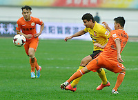 Elkeson of Guangzhou Evergrande, center, challenges Rao Weihui of Guizhou Renhe during the 28th round of the 2014 Chinese Football Association Super League in Guiyang city, southwest China's Guizhou province, 18 October 2014.<br /> <br /> Guangzhou Evergrande defeated Guizhou Renhe 2-1.