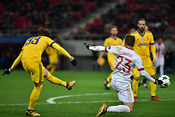 December 5, 2017 - Athens, Attiki, Greece - Despite the effort of Leonardo Kourtis (no 23) of Olympiacos, Federico Bernardeschi (no 33) has scored the second goal of Juventus. (Credit Image: © Dimitrios Karvountzis/Pacific Press via ZUMA Wire)