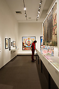 "A gallery in The American Folk Art Museum, with Paul Laffoley's ""Alchemy: the telenomic process of the Universe"" on the back wall."