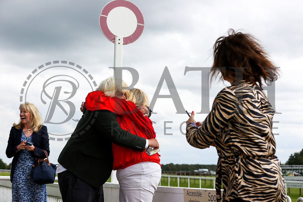 Owners celebrate as Air of York ridden by Megan Nicholls (T: Grace Harris) wins the 14:35 Home Of Winners At valuerater.co.uk Handicap (Div 1) - Rogan/JMP - 14/07/2020 - HORSE RACING - Bath Racecourse - Bath, England.