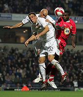 Photo: Paul Thomas.<br /> Blackburn Rovers v Basle. UEFA Cup. 02/11/2006.<br /> <br /> Shabeni Nonda (R) of Blackburn has his header blocked by Basel defenders Reto Zanni (23) and Daniel Majstorovic.