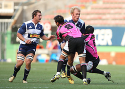 DHL Stormers captain Schalk Burger takes on the Boland defense during the final warm-up match before the start of the Super Rugby season between the DHL Stormers and the Boland Cavaliers held at DHL Newlands Stadium in Cape Town, South Africa on 12 February 2011. Photo by Jacques Rossouw/SPORTZPICS