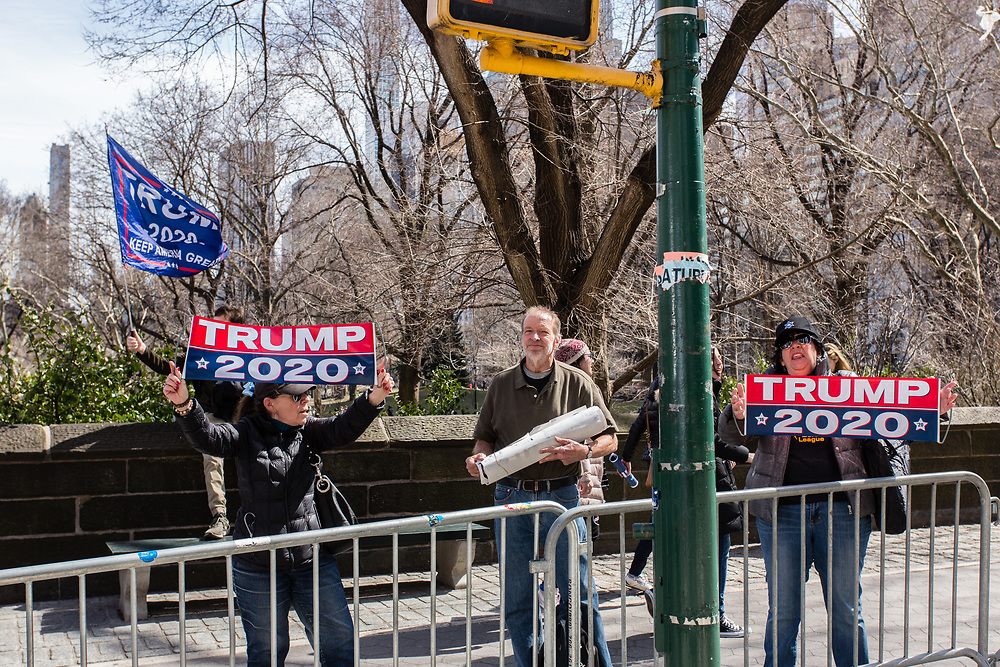 New York, NY - 24 March 2019. Senator Kirsten Gillibrand (D-NY) held a presidential campaign rally on New York's Central Park West in Front of the Trump Hotel  and Tower. A few Trump supporters were on the sidqalk outside the rally with signs and a banner.