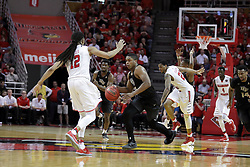 20 March 2017:  B.J. Taylor dribbles towards backpeddling Tony Wills(12) during a College NIT (National Invitational Tournament) 2nd round mens basketball game between the UCF (University of Central Florida) Knights and Illinois State Redbirds in  Redbird Arena, Normal IL