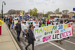 May 1, 2019 - Detroit, Michigan, U.S. - Detroit, Michigan - A May Day march demands restoration of driver's licenses to everyone without regard to immigration status. Michigan prohibited undocumented immigrants from getting licenses in 2008. (Credit Image: © Jim West/ZUMA Wire)