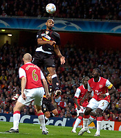 Photo: Ed Godden/Sportsbeat Images.<br /> Arsenal v Sevilla. UEFA Champions League Group H. 19/09/2007. Sevilla's Frederic Kanoute rises high to head the ball in the Arsenal area.