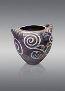 Luxury Minoan Kamares Ware storage poy with swirl olychrome decorations , Phaistos 1900-1700 BC; Heraklion Archaeological  Museum, grey background.<br /> <br /> This style of pottery is named afetr Kamares cave where this style of pottery was first found .<br /> <br /> If you prefer to buy from our ALAMY PHOTO LIBRARY  Collection visit : https://www.alamy.com/portfolio/paul-williams-funkystock/minoan-art-artefacts.html . Type -   Heraklion   - into the LOWER SEARCH WITHIN GALLERY box. Refine search by adding background colour, place, museum etc<br /> <br /> Visit our MINOAN ART PHOTO COLLECTIONS for more photos to download  as wall art prints https://funkystock.photoshelter.com/gallery-collection/Ancient-Minoans-Art-Artefacts-Antiquities-Historic-Places-Pictures-Images-of/C0000ricT2SU_M9w