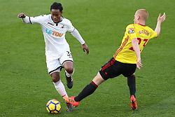 30 December 2017 - Premier League Football - Watford v Swansea City - Ben Watson of Watford stretches to intercept Renato Sanches of Swansea - Photo: Charlotte Wilson / Offside