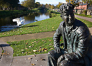 """Bronze casting of writer Brendan Behan, on the Royal Canal, Dublin, by sculptore John Coll. The bench and statue are near Mountjoy Prison, where Behan spent time; his play, the Quare Fellow, features a song called """"The Auld Triangle"""" which mentions the Royal Canal."""