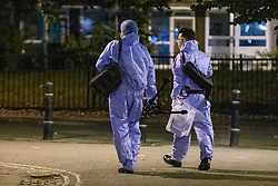 © Licensed to London News Pictures. 15/08/2021. London, UK. Forensic investigators gather evidence following reports of gunshots at a block party in Clarence Gardens, Camden at approximately 22:10BST on Saturday 14th August. Four people were taken to hospital and are being treated for suspected gunshot injurers. Photo credit: Peter Manning/LNP