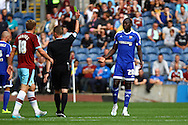 Toumani Diagouraga of Brentford receives a yellow card from referee David Webb. Skybet football league championship match, Burnley  v Brentford at Turf Moor in Burnley, Lancs on Saturday 22nd August 2015.<br /> pic by Chris Stading, Andrew Orchard sports photography.