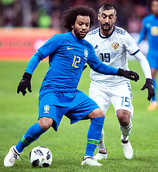 MOSCOW, March 24, 2018  Marcelo (L) of Brazil vies with Alexander Samedov of Russia during the international friendly match between Russia and Brazil at Luzhniki Stadium in Moscow, Russia, on March 23, 2018. Brazil won 3-0. (Credit Image: © Wu Zhuang/Xinhua via ZUMA Wire)