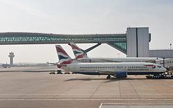 © licensed to London News Pictures. London, UK 23/03/2012. British Airways planes pictured at Gatwick Airport. Photo credit: Tolga Akmen/LNP