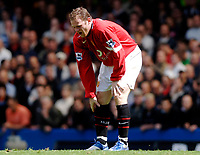 Photo: Daniel Hambury.<br />Chelsea v Manchester United. The Barclays Premiership. 29/04/2006.<br />United's Wayne Rooney feels his right foot after being fouled. This incident happened a few minutes before Rooney was injured and had to be taken off on a stretcher.