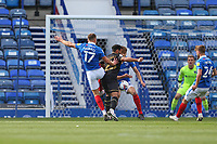 Football - 2020 / 2021 Sky Bet League One - Portsmouth vs. MK Dons<br /> <br /> Portsmouth's Bryn Morris pushes Louis Thompson of MK Dons to give away a penalty during the League One fixture at Fratton Park <br /> <br /> COLORSPORT/SHAUN BOGGUST