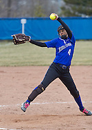 Middletown, New York - A Middletown pitcher winds up in a varsity girls' softball game on April 7, 2014.