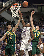 Kansas State's Cartier Martin (C) fights North Dakota State's Lucas Moormann (R) and Brett Winkelman (L) in the first half, during K-State's 82-56 win over North Dakota State at Bramlage Coliseum in Manhattan, Kansas, January 2, 2006.