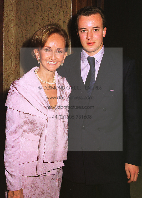 YVONNE, MARCHIONESS OF BRISTOL and her son LORD FREDERICK HERVEY, at a party in London on 13th November 1998.MLY 23