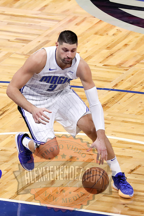 ORLANDO, FL - FEBRUARY 17:   Nikola Vucevic #9 of the Orlando Magic dribbles the ball against the New York Knicks at Amway Center on February 17, 2021 in Orlando, Florida. NOTE TO USER: User expressly acknowledges and agrees that, by downloading and or using this photograph, User is consenting to the terms and conditions of the Getty Images License Agreement. (Photo by Alex Menendez/Getty Images)*** Local Caption *** Nikola Vucevic