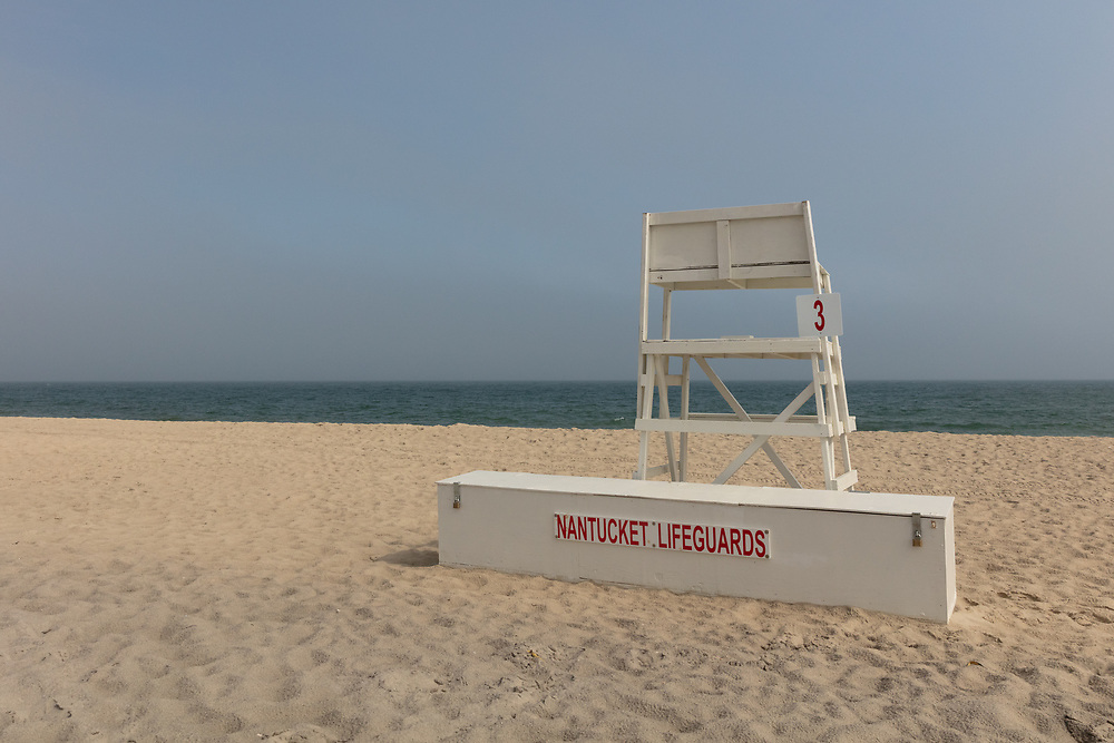 A Nantucket Lifeguard stand nestled in the sand at Surfside.