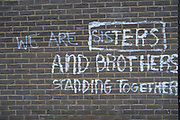 We are brothers and sisters standing together, graffiti in London, England, United Kingdom.