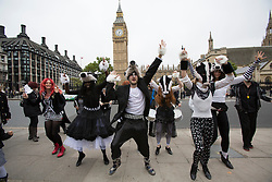 © licensed to London News Pictures. London, UK 21/10/2012. Protesters dressed as badgers dancing in a flashmob outside the Houses of the Parliament in London today 21st october 2012. They were protesting the government's proposed plans to cull thousands of the UK's badgers Photo credit: Tolga Akmen/LNP