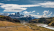 """Monte Fitz Roy is also known as Cerro Chaltén, Cerro Fitz Roy, or Mount Fitz Roy. The peak of Cerro Fitz Roy rises to 3405 m (11,171 ft) elevation above the resort of El Chalten in Santa Cruz Province, Argentina, Patagonia, South America. The first Europeans recorded as seeing Mount Fitz Roy were the Spanish explorer Antonio de Viedma and his companions, who in 1783 reached the shores of Viedma Lake. In 1877, Argentine explorer Francisco Moreno saw the mountain and named it Fitz Roy in honour of Robert FitzRoy who, as captain of HMS Beagle, had travelled up the Santa Cruz River in 1834 and charted large parts of the Patagonian coast. Mt Fitz Roy was first climbed in 1952. Cerro is a Spanish word meaning hill, while Chaltén comes from a Tehuelche (Aonikenk) word meaning """"smoking mountain"""", due to a cloud that usually forms around the peak. This image was stitched from multiple overlapping photos."""