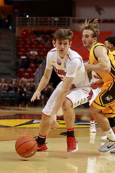 05 November 2016:   Matt Hein(5) guarded by Robby Dosier during an NCAA  mens basketball game where the Quincy Hawks lost to the Illinois State Redbirds in an exhibition game at Redbird Arena, Normal IL