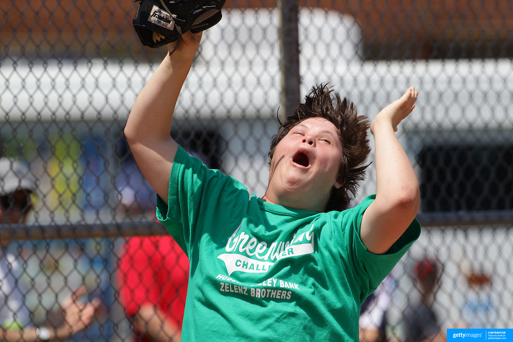 A player shows delight during his introduction during the Norwalk Little League baseball 'Champions' team V Greenwich in the Challenger Division  Recognition Day competition. The day acknowledged the many talents of the great players on the Challenger Division teams. The division has weekly games and practices for kids with special needs. Challenger division are held throughout the country.  Broad River Fields, Norwalk, Connecticut. USA. 2nd June 2013. Photo Tim Clayton