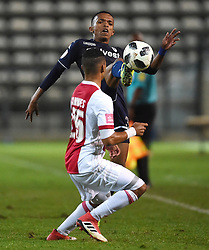 Cape Town-180411 Wits  striker Abednigo Mosiatlhaga challenged by Sergio Kammies  of Ajax  Cape Town in a PSL match played at Athlone stadium.photographer:Phando Jikelo/African News Agency/ANA
