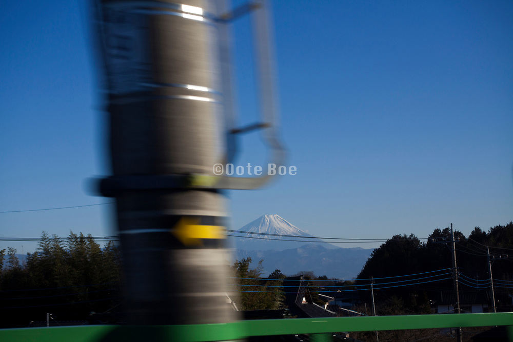 mount Fuji seen from a traveling train