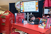 Thirteen-year-old Make-A-Wish kid, Reece King writes the inaugural letter to Santa using Macy's new Wish Writer stylus and app after a press conference to kick off the Macy's Believe Launch Friday, Nov. 6, 2015, in Macy's Oxmoor in Louisville, Ky., and announce his wish to raise a million dollars for charity that helps kids like him who are battling cancer and life-threatening diseases. (Brian Bohannon/AP Images for Macy's)