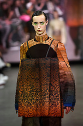 "© Licensed to London News Pictures. 05/06/2019. LONDON, UK.  A model presents a look by Brian Mc Lysaght from Edinburgh College of Art during the ""Best of GFW"" show on the final day of Graduate Fashion Week.  Taking place at the Old Truman Brewery in East London, the event presents the graduation show of up and coming fashion designers from UK and international universities.  Photo credit: Stephen Chung/LNP"
