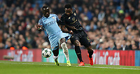 Football - 2016 / 2017 UEFA Champions League - Group C: Manchester City vs. Celtic<br /> <br /> Moussa Dembele of Celtic and Bacary Sagna of Manchester City the match at the Ethihad Stadium.<br /> <br /> COLORSPORT/LYNNE CAMERON
