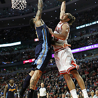 26 March 2012: Chicago Bulls center Joakim Noah (13) goes for the dunk over Denver Nuggets small forward Wilson Chandler (21) during the Denver Nuggets 108-91 victory over the Chicago Bulls at the United Center, Chicago, Illinois, USA. NOTE TO USER: User expressly acknowledges and agrees that, by downloading and or using this photograph, User is consenting to the terms and conditions of the Getty Images License Agreement. Mandatory Credit: 2012 NBAE (Photo by Chris Elise/NBAE via Getty Images)