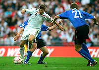 Photo: Tom Dulat.<br /> England v Estonia. UEFA European Championships Qualifying. 13/10/2007.<br /> Aleksandr Dimitrijev(back) of Estonia and Steven Gerrard of England fighting for the ball. no 21 Taavi Rahn of Estonia