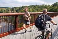 Rosendale, New York -Adam Meier runs along the trestle in Rosendale near the finish of the Shawangunk Ridge Trail Run/Hike 32-mile race on Sept. 20, 2014.