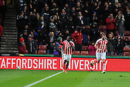 Victor Moses of Stoke city (l) celebrates after he scores his teams 1st goal.  Barclays Premier League match, Stoke city v Everton at the Britannia Stadium in Stoke on Trent , Staffs on Wed 4th March 2015.<br /> pic by Andrew Orchard, Andrew Orchard sports photography.