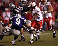 Nebraska running back Marlon Lucky (20) slips past Kansas State safety Kyle Williams (9) for a 40-yard touchdown in the third quarter at Bill Snyder Family Stadium in Manhattan, Kansas, October 14, 2006.  The Huskers beat the Wildcats 21-3.<br />