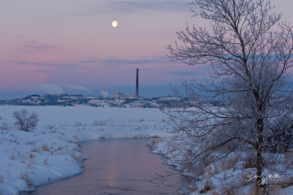 Setting moon over Vale INCO Iron Ore recovery plant near Kelly Lake, Sudbury, Ontario, Canada