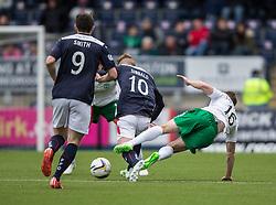 Hibernian's Lewis Stevenson tackles Falkirk's Craig Sibbald. <br /> Falkirk 0 v 3 Hibernian, Scottish Championship game played at The Falkirk Stadium 2/5/2015.